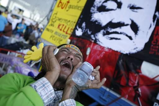 Un manifestant anti-gouvernement... (Photo: AP)