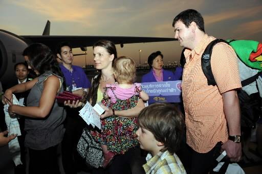 Une famille australienne s'apprête à embarquer dans un... (Photo: AFP)