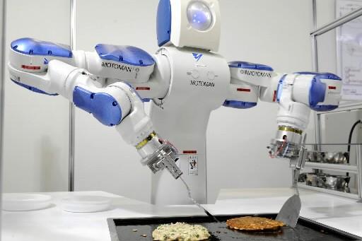 Le dernier-né des robots japonais, Motoman spécialisé dans... (Photo: AFP)