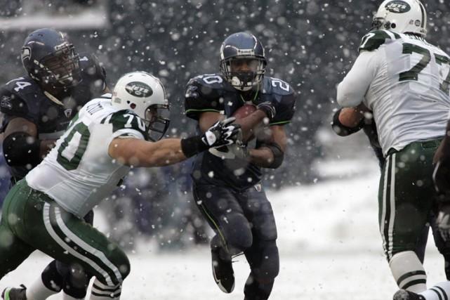 Si Brett Favre connaît habituellement du succès dans ce genre de météo, il... (Photo: Reuters)