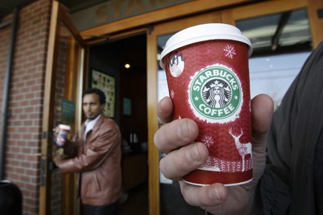 Starbucks a annoncé mercredi que ses profits avaient chuté de 77 pour cent au... (Photo: AP)