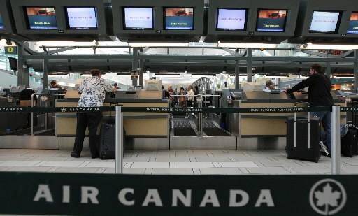 Le nombre de sièges vides à bord des avions d'Air Canada (T.AC.B)... (Photo: La Presse Canadienne)