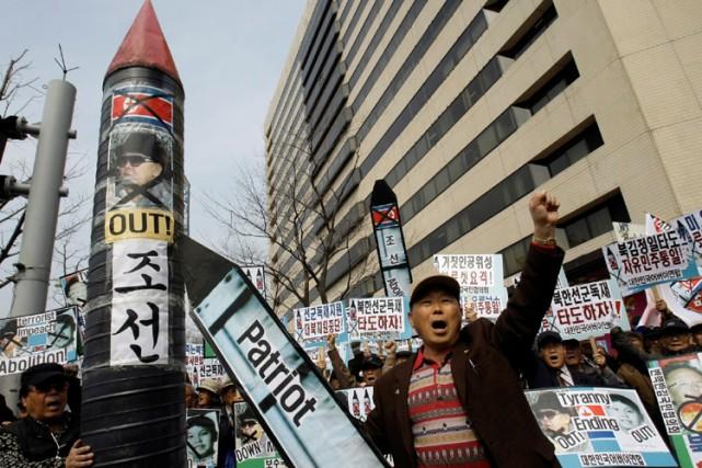 Des Sud-coréens se sont réunis à Séoul pour... (Photo:AP)