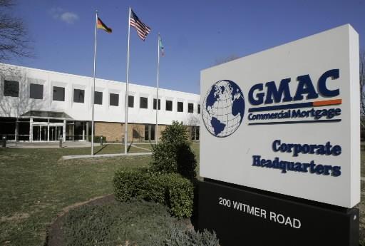 Le groupe américain de services financiers GMAC, qui assure le financement des... (AP)