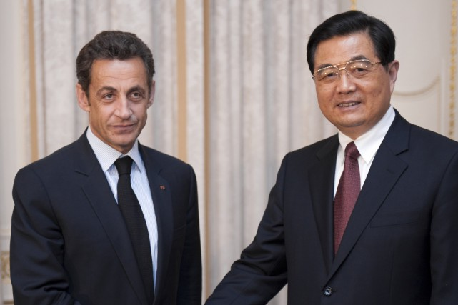 Nicolas Sarkozy et Hu Jintao... (Photo: Reuters)