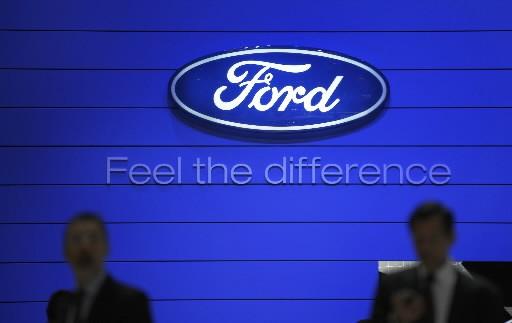 Le constructeur automobile boucle la restructuration de sa dette, qui s'élevait... (Photo: Agence France-Presse)