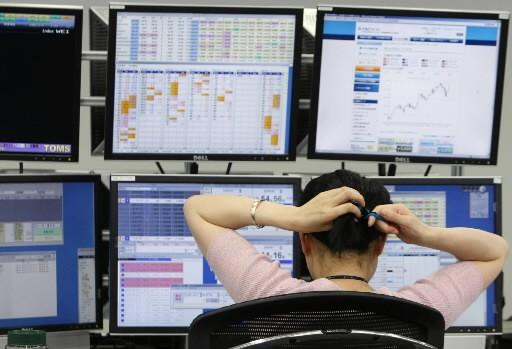 Inquiets en se demandant quel sera l'impact de la récession sur les résultats... (Photo: Reuters)