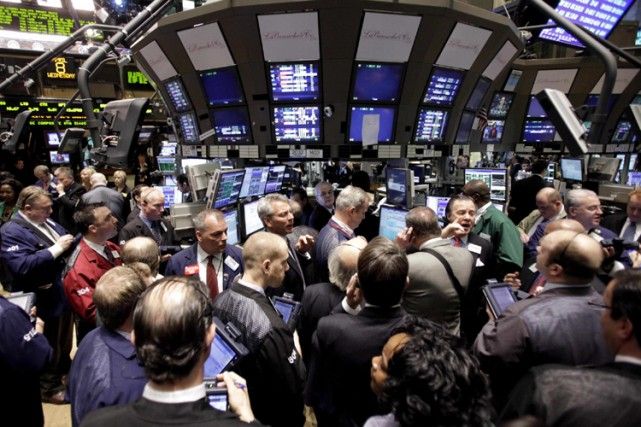 Les principaux marchés nord-américains ont tous terminé en hausse jeudi, les... (Photo: AP)