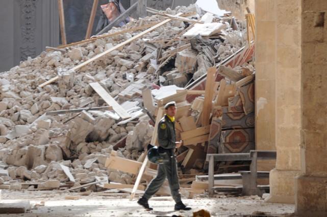 Le séisme qui a secoué l'Italie a été... (Photo: AFP)