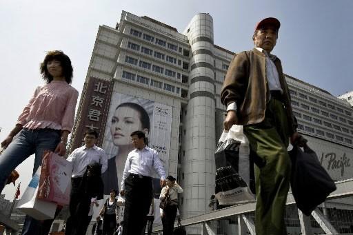 La Chine s'est engagée lundi à promouvoir les droits de l'Homme, dans le... (Photo AP)