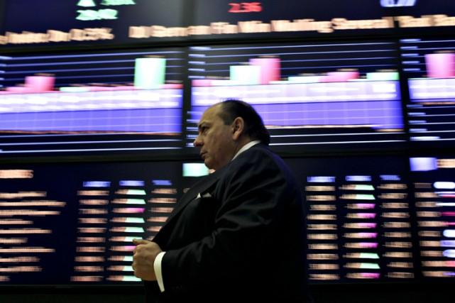 Les bourses nord-américaines ont clôturé en baisse mardi, à la suite de la... (Photo: Bloomberg News)