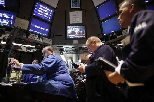 Un rebond d'énergie du secteur financier en fin de journée a permis à la Bourse... (Photo: Associated Press)