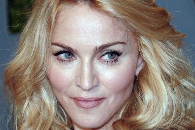 Madonna... (Photo: AP)