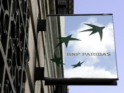 La restructuration mondiale chez BNP Paribas atteint le siège social canadien à... (Photo: Associated Press)