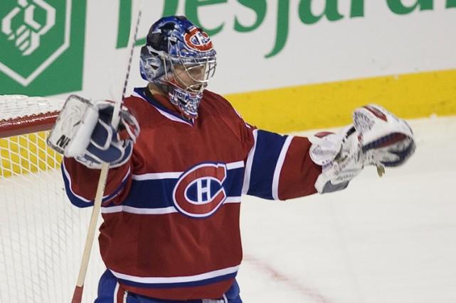 Carey Price a levé les bras au ciel... (Photo: André Pichette, la Presse)
