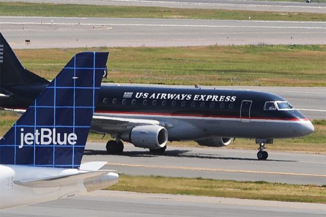 La compagnie aérienne US Airways a annoncé jeudi une forte réduction de ses... (AP)