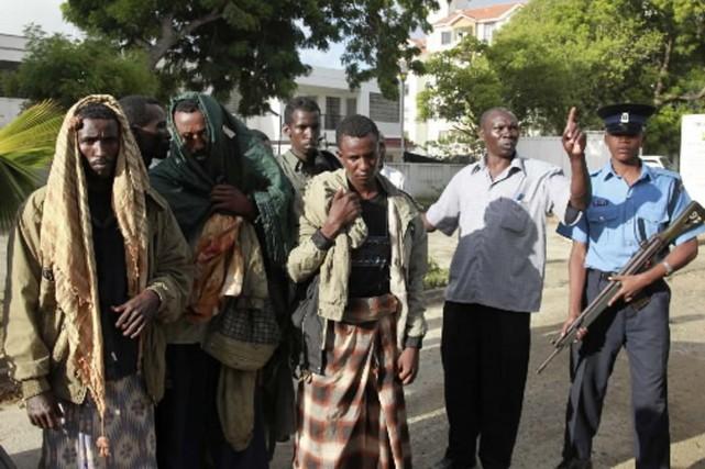 Un tribunal kényan a inculpé jeudi 23 individus après le massacre à coups de... (Photo Associated Press)