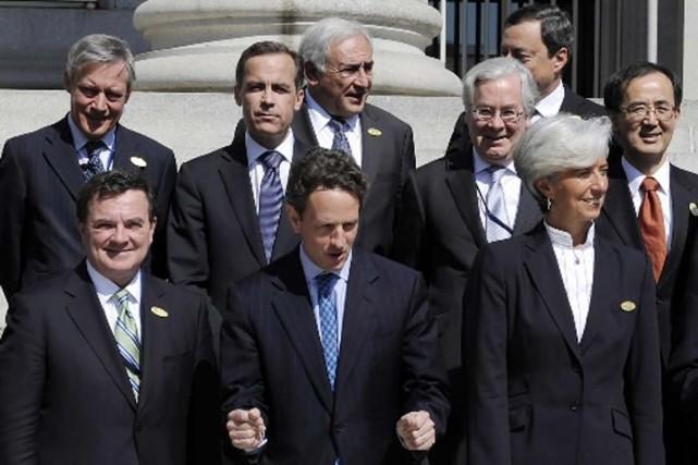 Le ministre Flaherty et ses homologues à Washington.... (Photo Reuters)