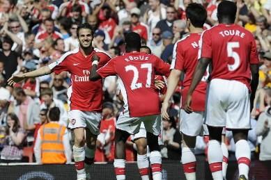 Arsenal a virtuellement assuré sa quatrième place du championnat d'Angleterre,... (Photo: AFP)