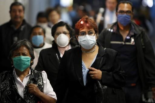 Des Mexicains à la sortie d'une bouche de... (Photo: AP)