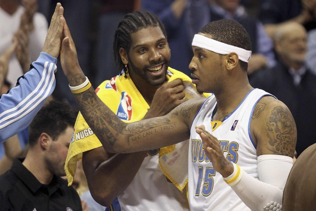 Carmelo Anthony et Nene... (Photo: Reuters)