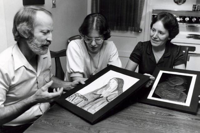 Le père, la soeur et la mère de... (Photo: Denis Courville, archives La Presse)