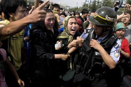 Des affrontements ayant opposé des Ouïghours à des... (Photo: AP)