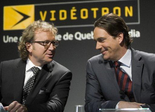 Robert Dépatie, PDG de Vidéotron, et Pierre Karl... (Photo Canadian Press)