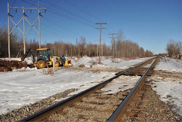 En enjambant la voie ferrée entre la 7e... (Photothèque le Soleil, Patrice Laroche)