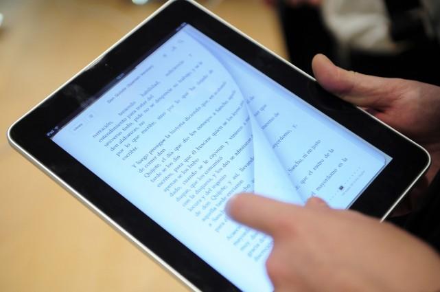 Le papier électronique a sept fois moins d'impact... (PHOTO: MANU FERNANDEZ, AP)