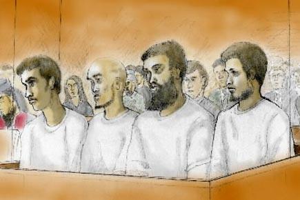 De gauche à droite: Zakaria Amara, Asad Ansari,... (Photo d'un dessin de cour, archives PC)