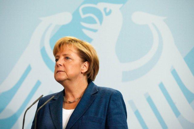 La chancelière allemande Angela Merkel a affirmé samedi... (PHOTO: DAVID GANNON, AFP)