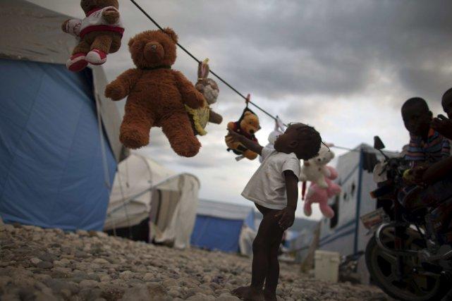 Les Haïtiens réfugiés au camp de Caradeux depuis... (Photo: AP)