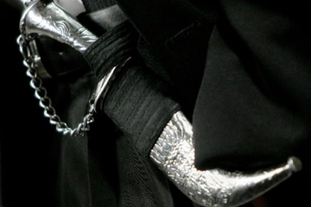 Le kirpan est un couteau traditionnel faisant office... (Photo: Chris Wattie, Reuters)