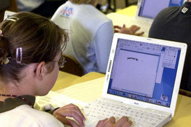 L'ordinateur portable en classe fait de petits miracles chez les élèves de la... (Archives La Tribune)
