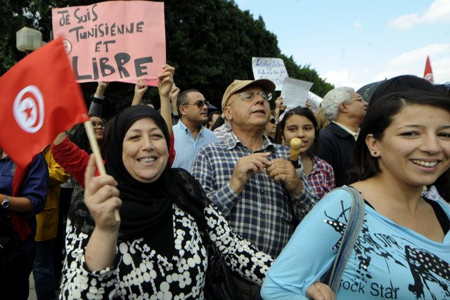 «Le peuple veut la liberté d'expression», «La Tunisie... (Photo Fethi Belaid, AFP)