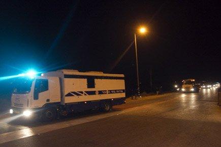 Un premier convoi de 96 prisonniers palestiniens a... (Photo: Reuters)