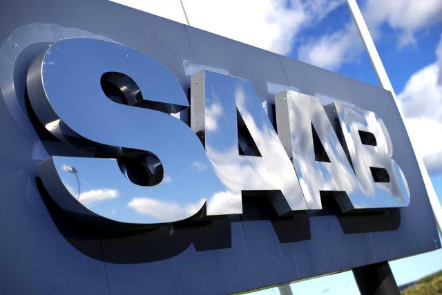 Les constructeurs automobiles néerlandais Spyker et suédois  Saab ont porté... (Photo AFP)