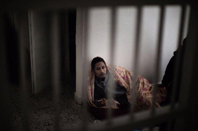 Un détenu dans la prison Djeida à Tripoli.... (Photo: Marco Longari, AFP)