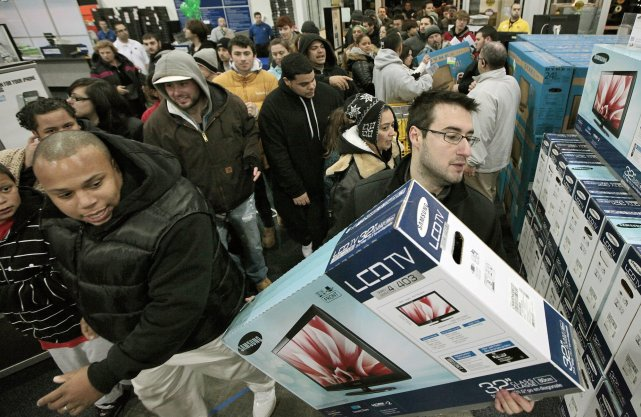 Aux États-Unis le 25 novembre, les consommateurs se... (AP)