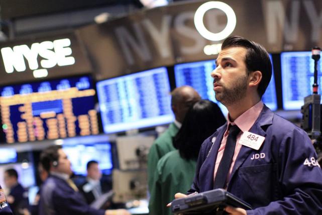 Wall Street a fini en petite baisse mardi, après que des inquiétudes dans les... (Reuters)