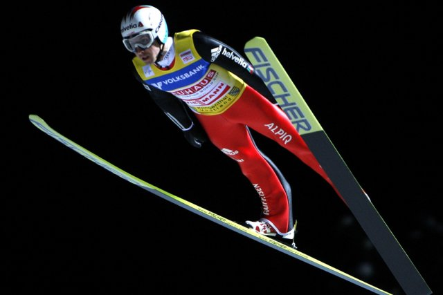 Le Suisse Simon Ammann, deux fois double champion... (Photo: Reuters)