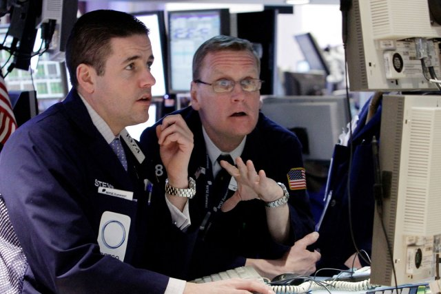 Le Dow Jones, l'indice vedette de Wall Street, a dépassé mardi en clôture, pour... (Photo AP)