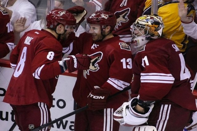 Gilbert Brule, Ray Whitney et Mike Smith célèbre... (Photo Reuters)