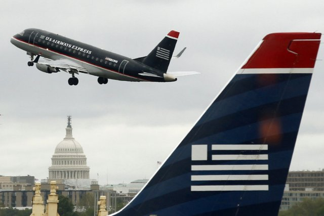 La fusion American Airlines-US Airways risque de retarder d'au moins deux ans... (Photo Reuters)