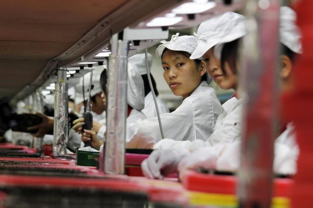 Employés d'usine de Foxconn en Chine.... (Photo archives Reuters)