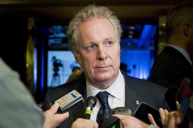 Le premier ministre du Québec, Jean Charest.... (Photo: Graham Hughes, PC)