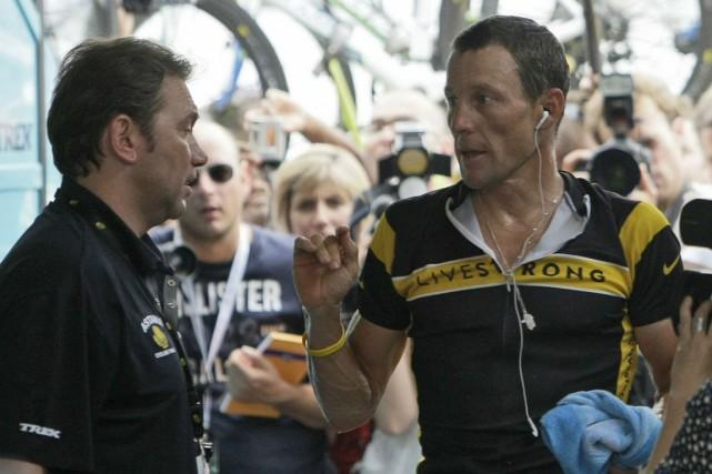 Johan Bruyneel et Lance Armstrong en 2009.... (Photo Laurent Rebours, archives AP)