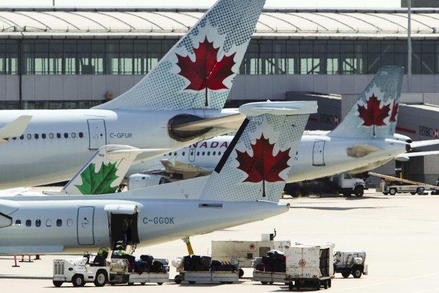 Le transporteur aérien Air Canada (T.AC.B)a révélé lundi que... (PHOTO MARK BLINCH, REUTERS)