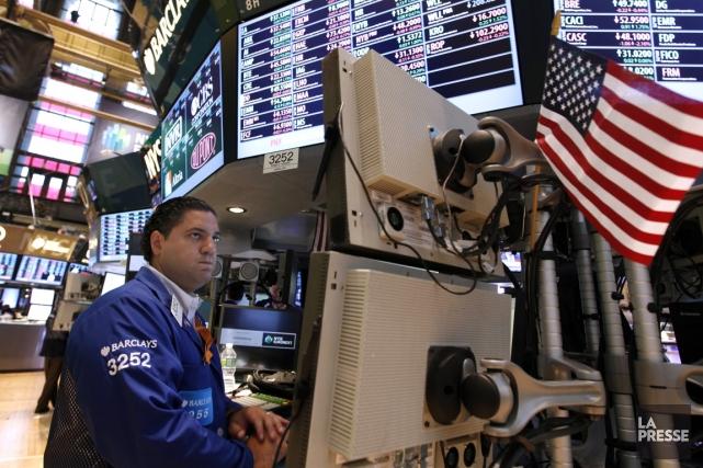 Alors que le TSX reculait de plus de 50 points, Wall Street a terminé en hausse... (Photo Associated Press)